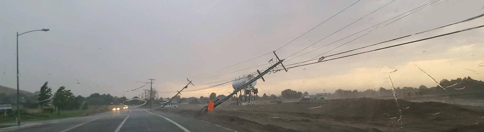 Downed power lines next to the road.